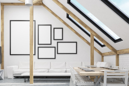 laid: Attic interior with a sofa, laid table and framed picture gallery on white wall. Concept of living room. 3d rendering. Mock up. Stock Photo