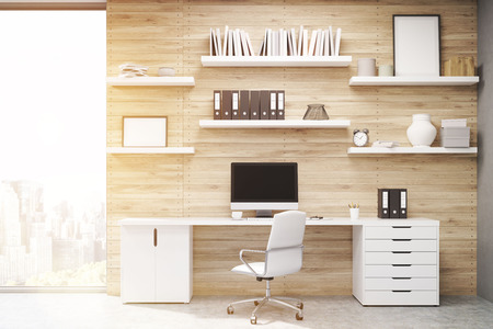 freelancing: Home office with light wood panels, large writing table with workstation and multiple shelves with posters. Concept of freelancing. 3d rendering. Mock up. Toned image Stock Photo