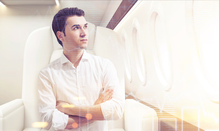 concentrate on: Portrait of young businessman sitting in business class of a plane with his arms crossed. Concept of success and luxury. Toned image. Double exposure. 3d rendering.