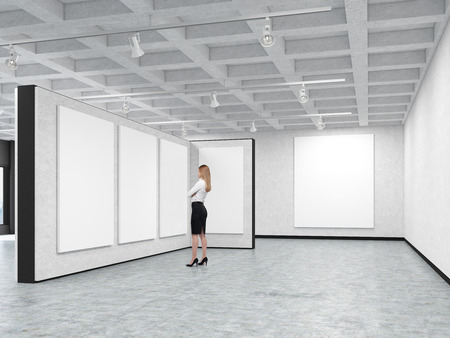 hanging woman: Woman is standing in an art gallery with blank posters hanging on the walls. Concept of modern art and advertising. 3d rendering. Mock up.