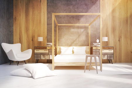 bedside: Bedroom interior containing a bed with pillars, an armchair and two bedside tables. Large pillows are laying on the floor. 3d rendering. Mock up. Toned image