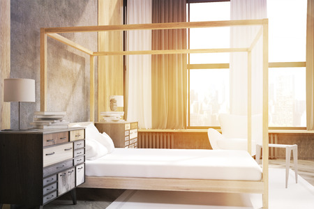 headboard: Side view of bedroom interior containing a bed with pillars, an armchair and two bedside tables. Large curtained panoramic windows. 3d rendering. Mock up. Toned image Stock Photo