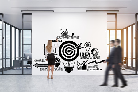 toning: Rear view of a woman drawing a business poster on a large white wall with two conference rooms by both sides. 3d rendering. Toned image