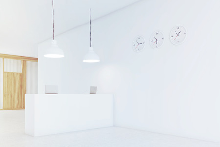 Office counter is standing in a lobby with three clocks on white wall. Wooden door is seen in the background. 3d rendering. Mock up. Toned image