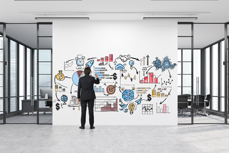 spacious: Rear view of a man drawing a business poster on a large white wall with two conference rooms by both sides. 3d rendering.