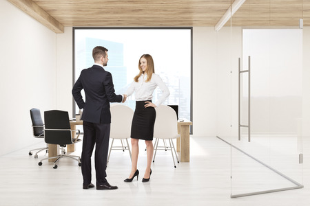 board meeting: Man and woman shaking hands in conference room with large square window; glass wall and a table with computers. Concept of board meeting. 3d rendering.