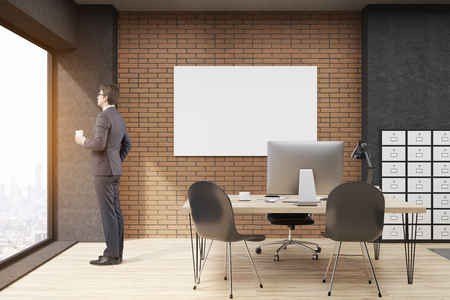 Man with cup of coffee is standing in  office with filing cabinet and horizontal poster. CEO desk is standing near panoramic window with cityscape. 3d rendering. Mock up. 写真素材 - 112977899