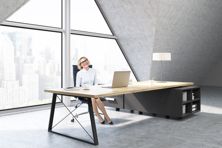 ceo office: Woman sitting in a CEO office with a large triangular window, a large table with a notebook and a lamp. 3d rendering. Mock up