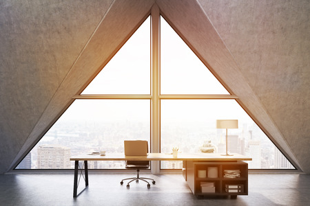 ceo office: Front view of a CEO office with a large triangular window, a large table with a notebook and a lamp. 3d rendering. Mock up. Toned image Stock Photo