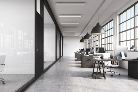 office computer: Front view of a long office room with concrete floor, long tables with desktops and big ceiling lamps. 3d rendering.