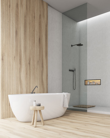 Corner of a bathroom with a wooden part of the wall and floor. Shower cabin with glass door is at a side of the room. A towel is hanging on the bathtub. 3d rendering. Mock up Imagens