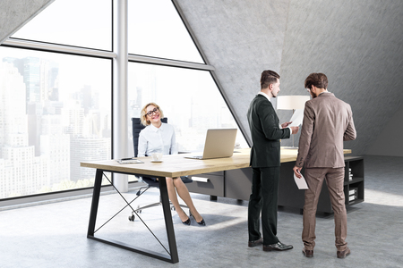 ceo office: Woman sitting and men talking in a CEO office with a large triangular window, a large table with a notebook and a lamp. 3d rendering. Mock up