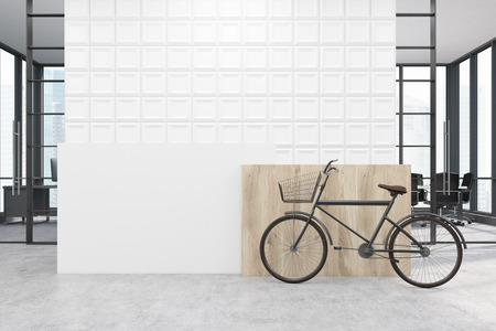 standing reception: Office with white tiles on the wall behind a reception counter. A bicycle is standing near it. A conference room in the background. 3d rendering. Mock up