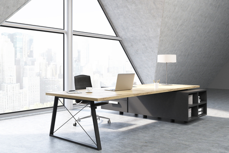 ceo office: Side view of a CEO office with a large triangular window, a large table with a notebook and a lamp. 3d rendering. Mock up Stock Photo
