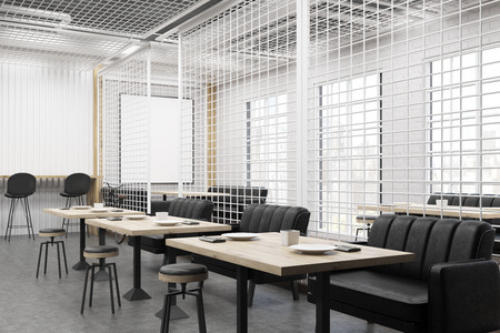 side view of a cafe interior with soft black sofas a wooden table and a - Large Cafe Interior