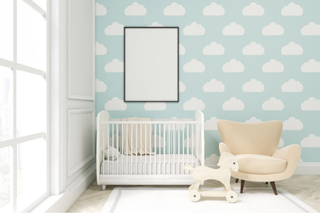 Close up of a child's room with a vertical framed poster, a cradle, an armchair and a toy horse. There is a large window and light blue cloud wallpaper. 3d rendering. Mock up
