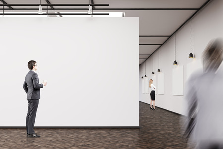 meet up: Businessman in dark suit is standing in an art gallery and looking at a picture. His colleague is going to meet him. A woman in the background. 3d rendering. Mock up