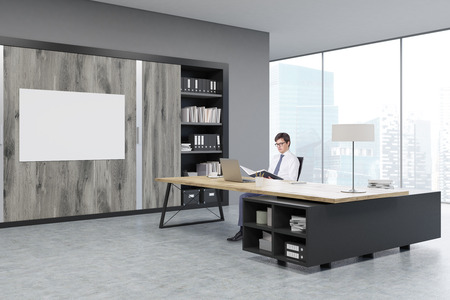 ceo office: Man sitting in a CEO office at a massive wooden table. There are wooden doors and a horizontal poster on the wall. 3d rendering. Mock up