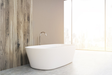 sinks: Side view of a white bathtub standing in a bathroom with gray and wooden walls. Two sinks are at the background. 3d rendering. Mock up. Toned image Stock Photo