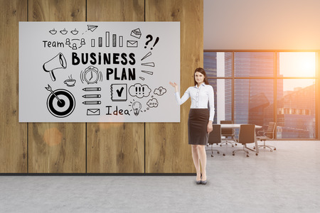 businesswoman standing: Portrait of a businesswoman standing near a large business plan poster hanging on a wooden wall in an office. 3d rendering. Toneed image