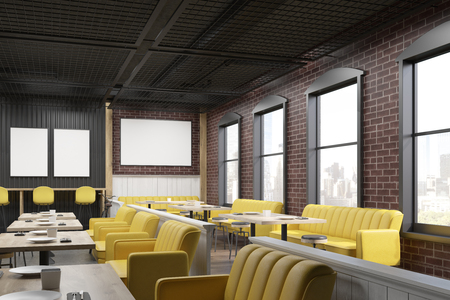 interior window: Cafe interior with yellow and beige sofas, wooden tables, and brick wall with posters hanging on them. 3d rendering. Mock up Stock Photo