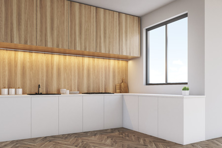 counter top: Corner of a kitchen interior with a long counter top, dining table and a window in a white wall. Wooden furniture. 3d rendering. Mock up. Stock Photo