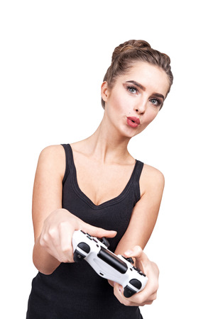 Portrait of a geeky teen girl holding a video game controller and enjoying her pastime