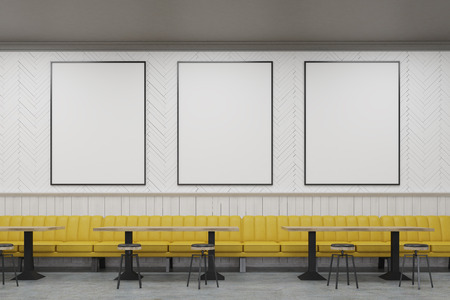 retro restaurant: Three vertical framed posters on a cafe wall with yellow sofas and small wooden tables. 3d rendering. Mock up.