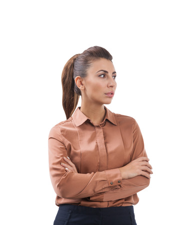 Isolated portrait of a serious woman standing with her arms crossed and wearing a brown blouse. Mock up Stock Photo