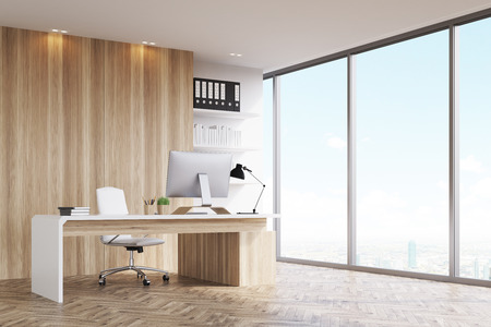 Office of a head of a company with light wood walls, a panoramic window and a table with computer on it. 3d rendering. Mock up.