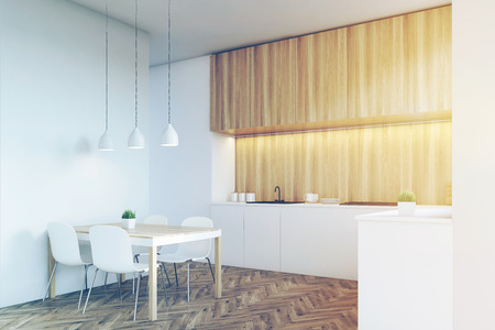 counter top: Side view of a kitchen interior with a long counter top and a dining table near a white wall. Wooden furniture. 3d rendering. Mock up. Toned image