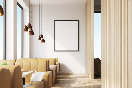 Cafe interior with wooden elements of decoration, a framed vertical poster hanging on a white wall and beige sofas. 3d rendering. Mock up.