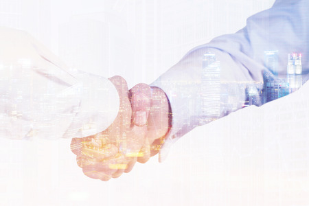 Close up of two men shaking hands. One is wearing a white shirt, his colleague is wearing a blue one. 3d rendering. Toned image. Double exposure Stock Photo