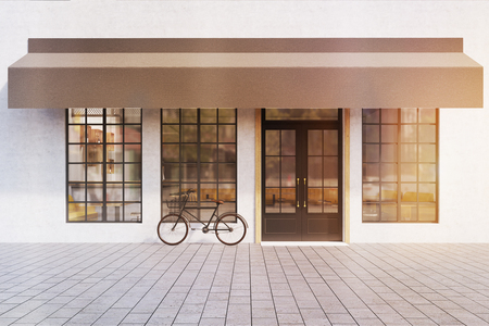 outdoor dining: Front view of a cafe entrance with large windows  and a bicycle near the door. 3d rendering. Mock up. Toned image Stock Photo