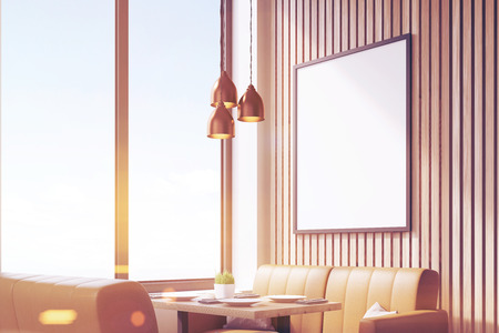 Close up of a blank poster in a coffee shop interior with beige leather sofas and large windows. 3d rendering. Mock up. Toned image Stock Photo