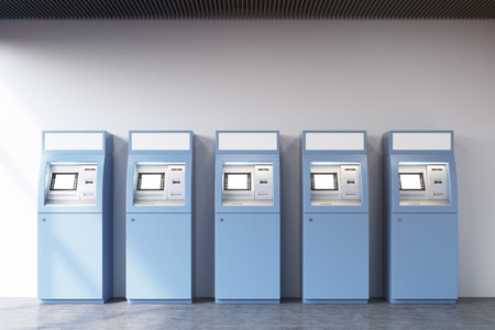 checking accounts: View of a row of five blue ATM machines standing near a concrete wall. Concept of monetary operations. 3d rendering. Mock up