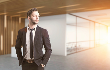 wealthy lifestyle: Portrait of a businessman with a beard. He is wearing a suit and standing with his hands in pockets. There is a conference room in the background. 3d rendering. Toned image