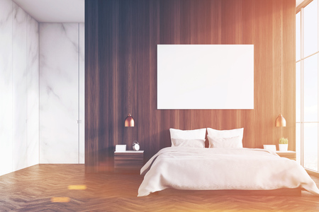 image size: Front view of a bedroom interior with a king size bed, dark wooden and marble walls, panoramic window and a horizontal poster. 3d rendering. Mock up. Toned image Stock Photo