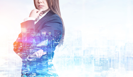 double chin: Close up of a woman with long hair wearing a suit. There is a city panorama in the foreground. Toned image. Mock up. Double exposure