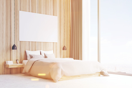 cozy: Side view of a double bed standing in a room with panoramic windows. There is a large horizontal poster on a light wood wall. 3d rendering. Mockup. Toned image