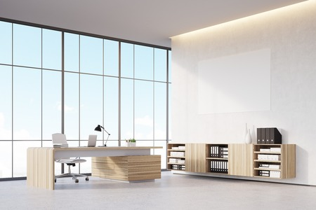 ceo office: Corner of a sunlit CEO office with wooden furniture, panoramic window and a horizontal poster on a white wall. 3d rendering. Mock up.