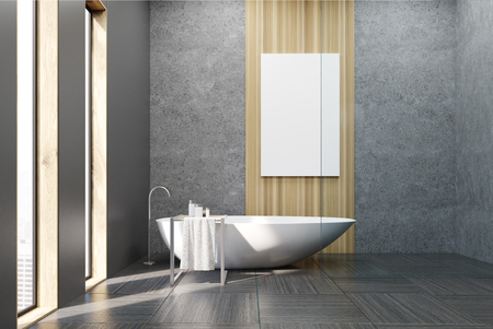 wooden panel: Interior of a bathroom with narrow windows, white tub, concrete and gray walls and a large vertical poster hanging on a wooden panel. 3d rendering. Mock up. Stock Photo
