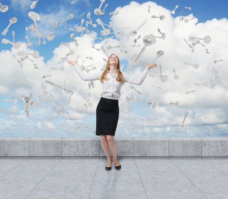 businesswoman standing: Portrait of a blond businesswoman standing on a rooftop with her hands in the air. Keys are falling from the sky. 3d rendering.