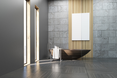 wooden panel: Interior of a bathroom with narrow windows, wooden tub, concrete and gray walls and a large vertical poster hanging on a wooden panel. 3d rendering. Mock up. Stock Photo