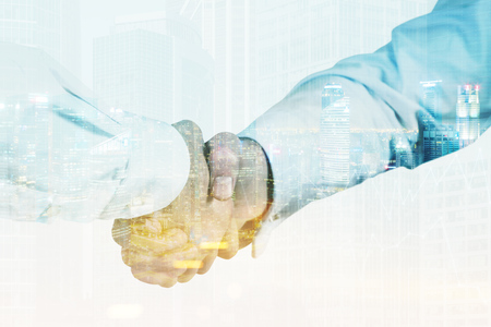 Close up of two men shaking hands. One is wearing a white shirt, his colleague is wearing a light blue one. 3d rendering. Toned image. Double exposure Stock Photo