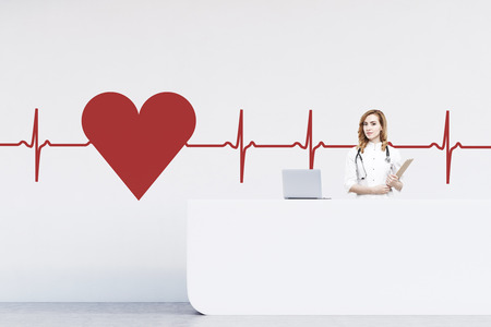red haired woman: Red haired woman receptionist standing at a counter in a hospital. There is a large heart sketch and a cardiogram on the wall. 3d rendering. Mock up Stock Photo