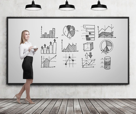 Side view of a blond woman with long hair holding her cup of coffee and standing near a whiteboard with graphs on it. Concept of statistics. 3d rendering. Mock up