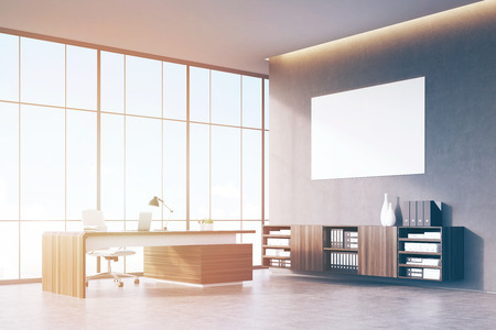 ceo office: Side view of a sunlit CEO office with wooden furniture, panoramic window and a horizontal poster on a gray wall. 3d rendering. Mock up. Toned image