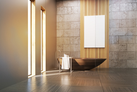 wooden panel: Interior of a bathroom with narrow windows, wooden tub, concrete and gray walls and a large vertical poster hanging on a wooden panel. 3d rendering. Mock up. Toned image Stock Photo
