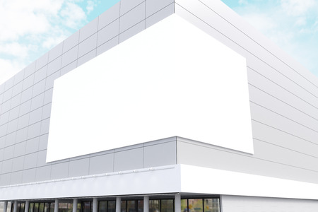 blank billboard: Exterior of a business center with a large billboard on the corner of the building. 3d rendering. Mock up.